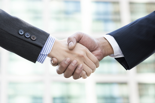 Firm handshake of businessman